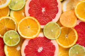 Fresh citrus fruits colorful background
